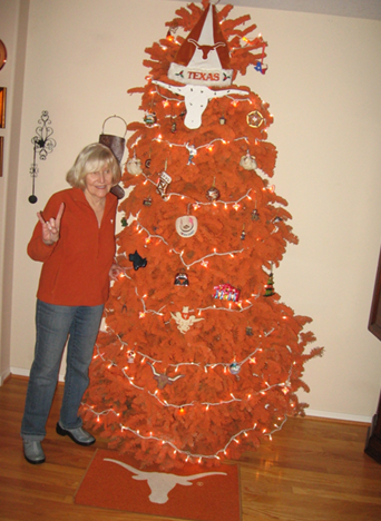 tony callanan sent this photo of his wife virginia dagerath callanan ba 64 with their familys very burnt orange christmas tree this past december - Orange Christmas Tree