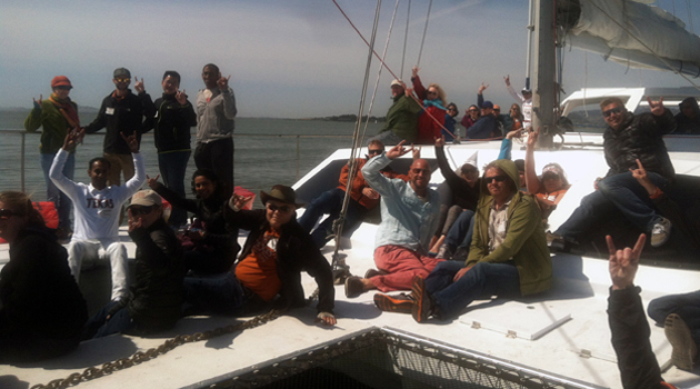 UT alumni throw their horns up during a San Francisco Boat Party fundraising event on Saturday, May 25.