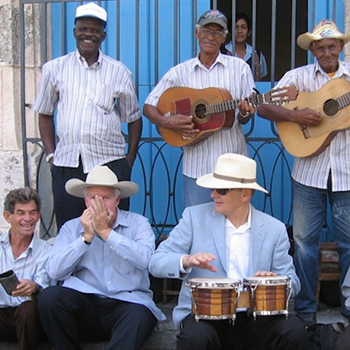 Two-visiting-yankis-sit-in-with-a-Havana-street-band.-The-author-plays-the-bongos-and-on-my-right-John-Parke-Wright-a-Florida-cattleman-riffs-on-the-harmonica.